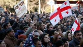 Georgians rally to support embattled opposition TV