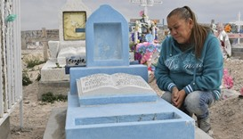 Maria Guadalupe Guereca, 60, visits the grave of her murdered son Sergio Hernandez