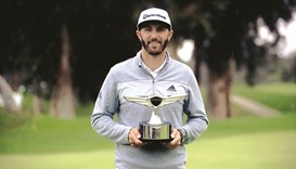 Johnson cruises to a five-shot victory  and No. 1 ranking