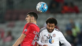 UAE Al-Jazira's Mohamed Jamal (R) fights for the ball with Qatar Lekhwiya's karim Boudiaf