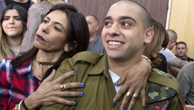 Israeli soldier Elor Azaria is embraced by his mother at the start of his sentencing hearing at a mi