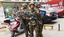 paramilitary police standing guard outside a shopping mall in China's Xinjiang region