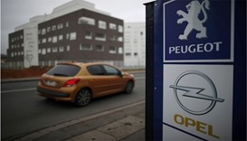 Merkel 'positive' about Peugeot's Opel takeover