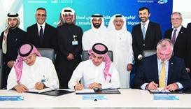 The main contractor agreement for Al Thumama Stadium being signed as al-Thawadi, architect Jaidah an