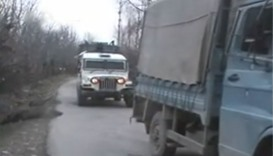 Army vehicles patrolling the streets after the attack.- Kashmir