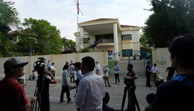 Members of the media gather in front of the North Korea embassy in Kuala Lumpur, Malaysia.