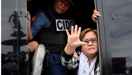 Philippine Senator Leila De Lima waves to her supporters after appearing at a court in Muntinlupa Ci