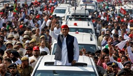 Akhilesh Yadav waves at his supporters during election campaign in Lucknow