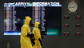 A Hazmat team conducts checks at KLIA2 airport terminal in Sepang, Malaysia.
