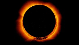 Sun spots are seen as the moon moves into a full eclipse position after reaching annularity during t
