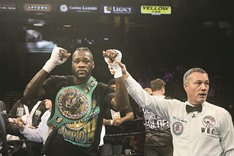 Wilder stops Washington to retain WBC crown