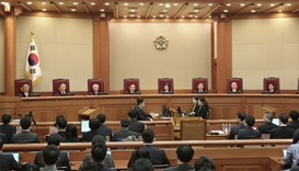Judges of the Constitutional Court sit during the final hearing on whether to confirm the impeachmen