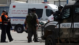 Israelis paramedics transport a Palestinian woman, who was shot and wounded by Israeli security forc
