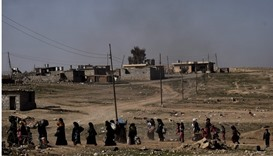 Displaced Iraqis flee the city of Mosul as Iraqi forces battle against Islamic State (IS) group