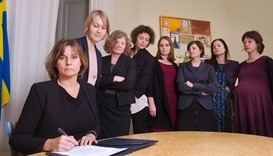 Swedish Environment Minister and Deputy Prime Minister Isabella Lovin (L) signs a referral of Swedis