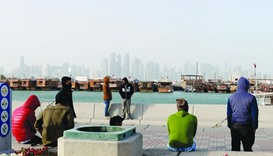 With mercury dropping to 10C in Doha, people had to pile on warm clothing and curtail outdoor activi