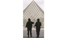 French police secure the site near the Louvre pyramid in Paris yesterday after a soldier shot and wo