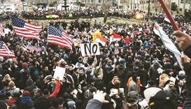 US courts hear challenges to travel ban