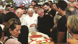 Lula holds vigil for late wife