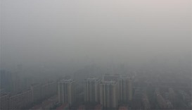 Smoggy Beijing to cut coal use 30% this year