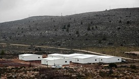 New prefabricated homes are seen under construction in the West Bank