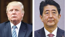 Donald Trump, left, and Shinzo Abe ... teeing off in diplomacy.