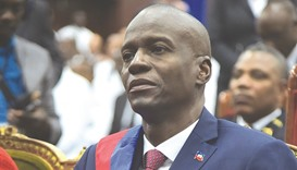 New Haitian President Jovenel Moise sits in the Haitian Parliament after receiving his sash during h