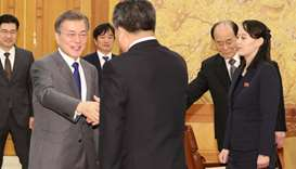 South Korean President Moon Jae-in shakes hands with president of the Presidium of the Supreme Peopl