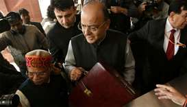 Indian Finance Minister Arun Jaitley (C) arrives at Parliament House to present the Union Budget in