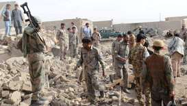 Afghan officials inspect the site of a truck bomb attack in Helmand on November 10, 2017
