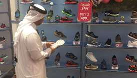 An official of the Ministry of Economy and Commerce inspecting a sports goods store.