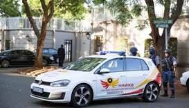 Police close off roads around the home of the Gupta family, friends of President Jacob Zuma, in Joha