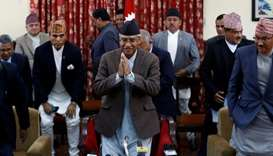 Nepalese Prime Minister Sher Bahadur Deuba greets as he leaves after announcing his resignation in K