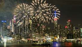 Fireworks explode against the backdrop of midtown Manhattan marking Chinese New Year celebrations