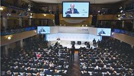 Wolfgang Ischinger, chairman of the Munich Security Conference (MSC), is displayed on giant screens