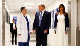 U.S. President Donald Trump and first lady Melania Trump visit with medical staff of Broward Health