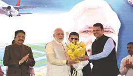 Maharashtra Chief Minister Devendra Fadnavis greets Prime Minister Narendra Modi in the presence of
