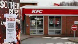 A closed sign hangs on the drive through of a KFC restaurant after problems with a new distribution