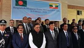 Myanmar home minister Gen Swe (C) and his Bangladesh counterpart Asaduzzaman Khan (3L) pose for a