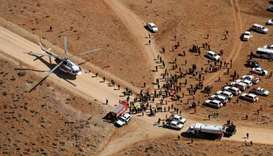 Iranian rescue teams gathering in the area of a search operation for the wreckage of a plane that cr