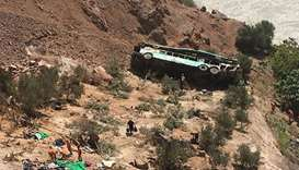 A bus is seen after run off the road and plunged into a ravine on the Panamerican road in southern P