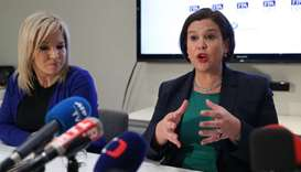 Sinn Féin President Mary Lou McDonald (R) addresses a press conference as Sinn Féin Vice-President M