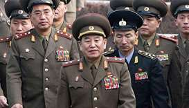 North Korea's chief delegate Kim Yong Chol (C) and North Korean soldiers crossing the border which d