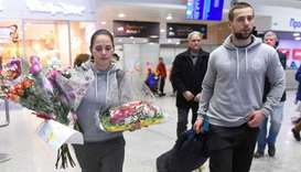 Russian Olympic curlers Alexander Krushelnitsky and his wife Anastasia Bryzgalova return from the Py