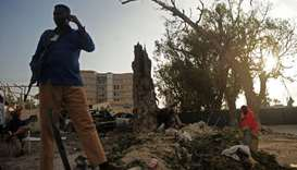 Somali security officer stands guard at the scene of a suicide car explosion in front of Doorbin hot