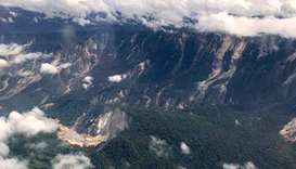 A handout photo shows several landslides on mountains in the Muller range after an earthquake struck