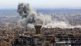 A general view taken from Damascus shows smoke rising from the rebel-held enclave of Eastern Ghouta
