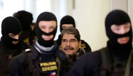 Kurdish Democratic Union Party (PYD) former leader Saleh Muslim is escorted to a Czech court