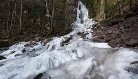 The frozen Nideck waterfall in Oberhaslach, eastern France