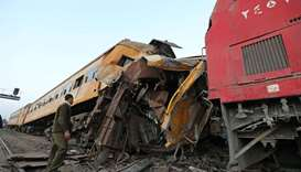 A policeman looks at the wreckage after a train crash in Kom Hamada in the northern province of Behe
